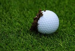 muddy golf ball