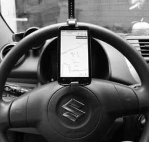 Steering wheel phone holders totally illegal, police warn