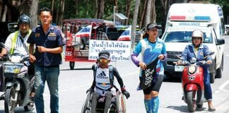 Uncle Mea and His Wheelchair Raising Funds on the Way to Chiag Mai